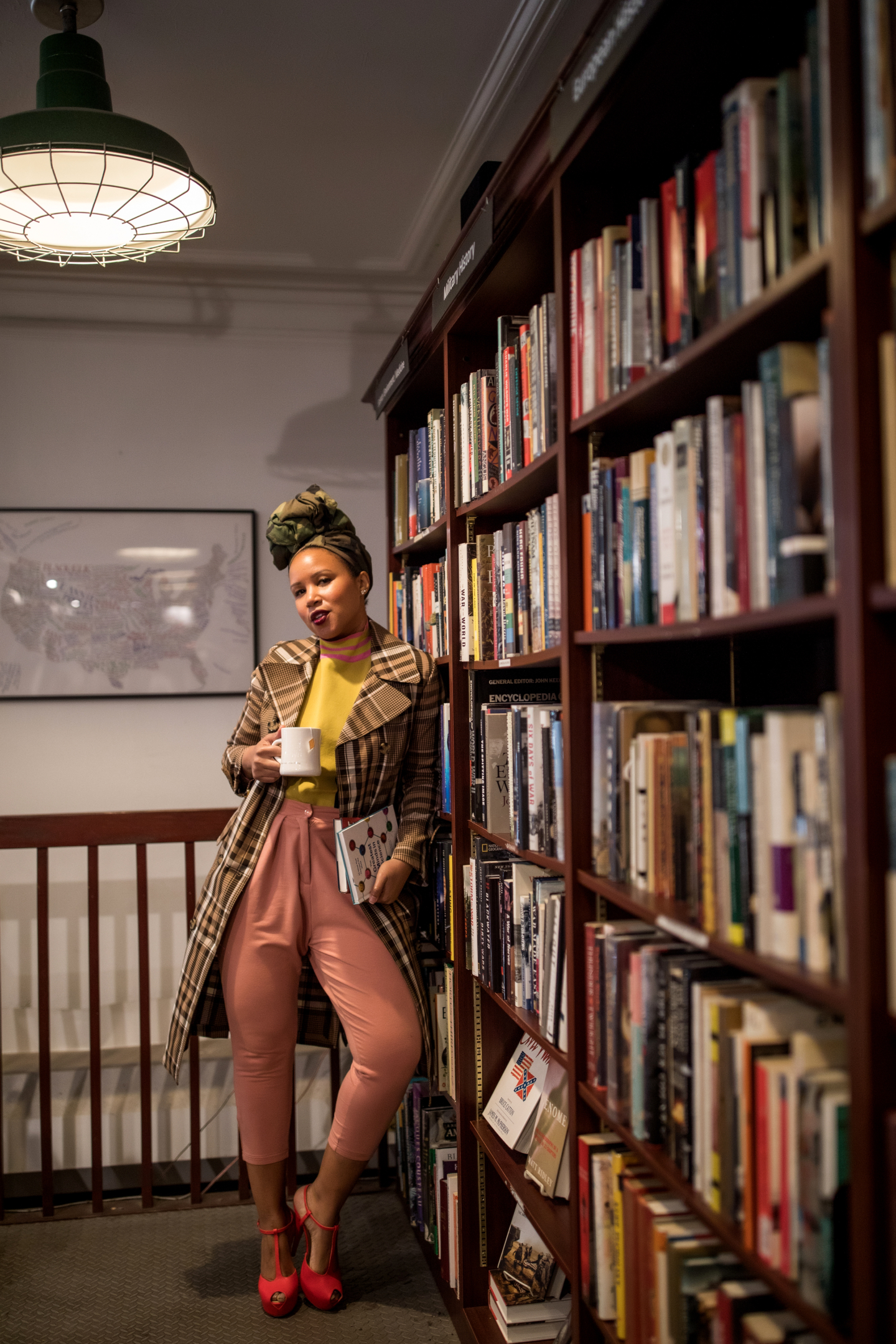 Library Plaid Coat ASOS Sweater and Pink Puma Pants Reading List